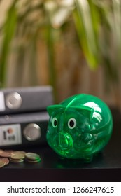 Green piggy bank and folder, Portrait