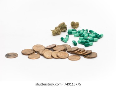 Green pills, cannabis or marijuana flower, and money against a white backdrop.