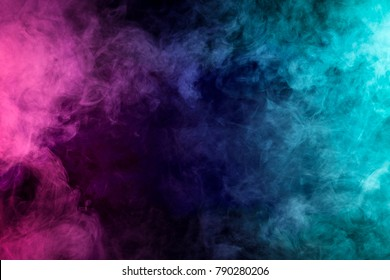 Green and pink abstract cloud of smoke pattern on a black isolated background