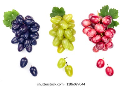 green pink and blue grapes with leaves isolated on the white background