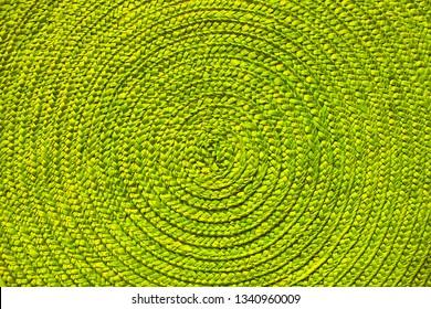 Green place mat wicker texture background.
