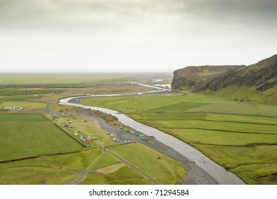 Green plain view from the top of Skogafoss waterfall (Iceland)