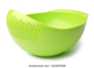Green plastic colander on white background