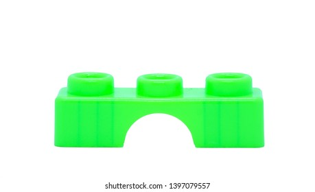 Green plastic construction brick toy  isolated on white background