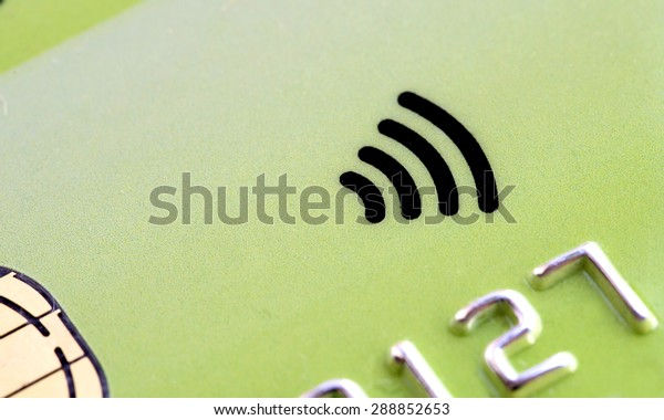 Green plastic  Credit card with contactless symbol electronic chip and money