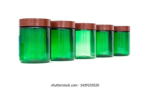 Green plastic jar with a lid on a white background, isolate, tara, Polyethylene terephthalate