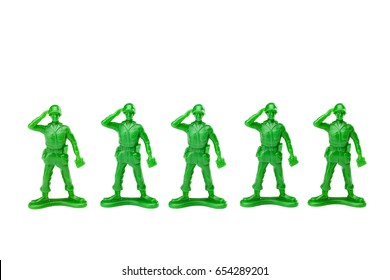 Green plastic vintage toy soldiers; isolated on white background