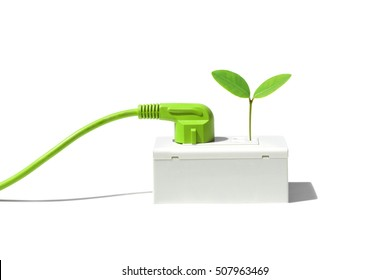 Green plug with a young green plant / Green energy concept