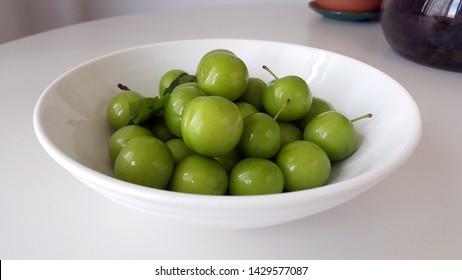 Green Plum Fruit on White Plate