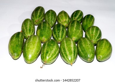 Green pointed gourds isolated on white background, green vegetables, green and seasonal vegetables from India. natural natural cultivation, cultivate in farm naturally