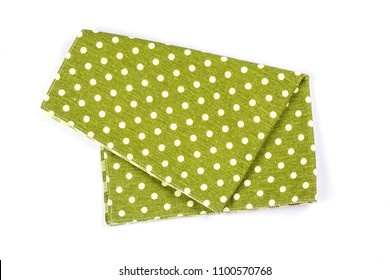 a green polka dot checkered napkin table clothes  on white background.
