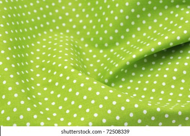 Grünes Polka-Punktgewebe in Vollrahmen