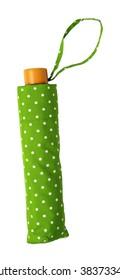 Green polka dot umbrella folded cover isolated on white background