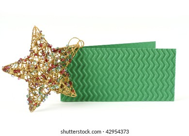 Green postcard with with beautiful golden star near it
