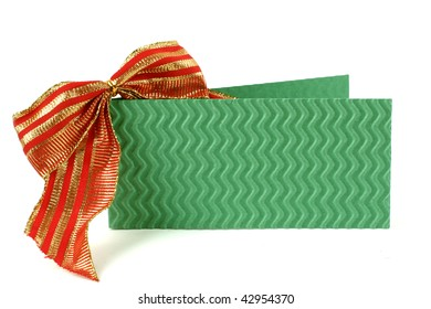Green postcard with striped red bow  near it