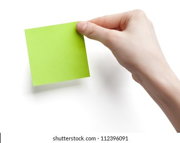 Green post-it note with hand on white background
