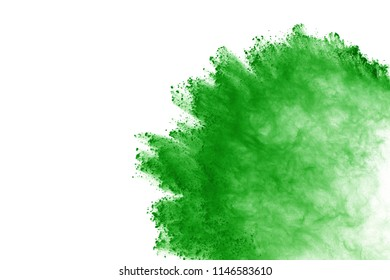 Green powder explosion on white background. Colored cloud. Color dust explode. Paint Holi.
