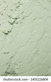 Green powder textured background, close up