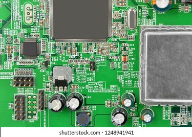 Green printed modem motherboard with microcircuit, close-up