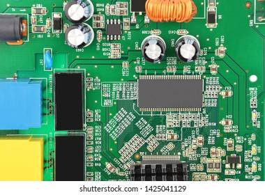 Green printed router motherboard with microcircuit, close-up
