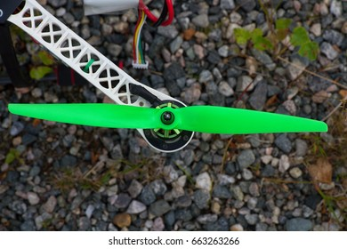 Green prop on the drone which is standing on shingle