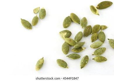 green pumpkin seeds  on White Background