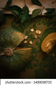 Green pumpking on the green table cloth flat lay dark food photography