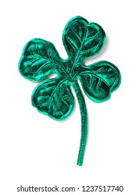green punched shamrock isolated over white