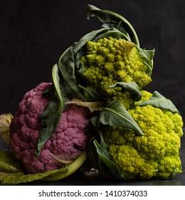 green and purple cualiflower and romanesco