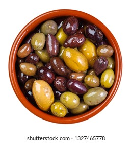 green and purple, mixed olives in clay bowl - isolated on white background