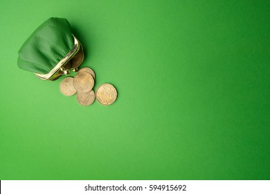 green purse coin EURO on green background. Top view