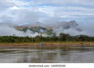 Green rainforest mountains in clouds, Amazon river basin at magical sunrise, South America