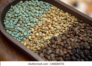green raw and brown roasted coffee beans close-up forming beautiful background