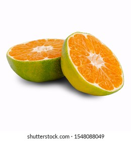 Green raw tangerine on white background with shadow. Design concept. Selective focus.