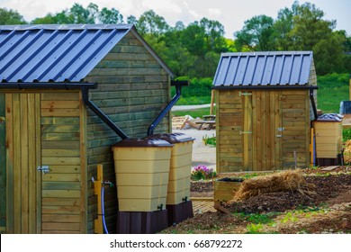 Green recovery of rainwater outside in town garden with small wooden cabin