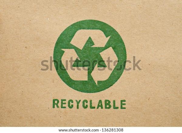 Green recycle symbol on cardboard