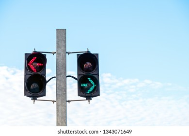 Green and red arrow safety light signals for pedestrians showing direction