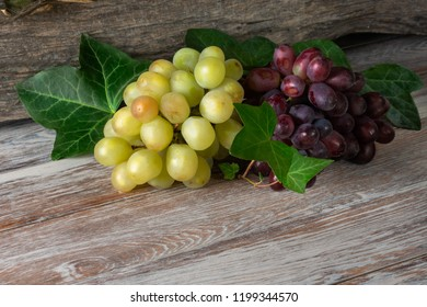 Green and red bunch of grapes, bunch of grapes on a wooden background. green, red grapes, a bunch of green grapes, a bunch of red