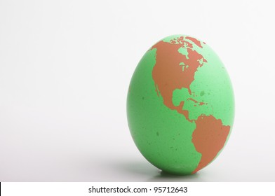 Green and red egg with image of globe, America as main focus