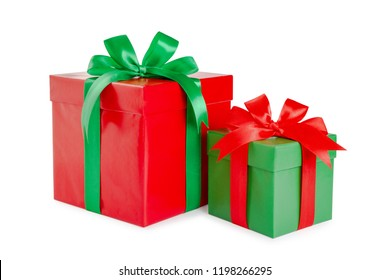 green and red gift box with a ribbon and a bow isolated