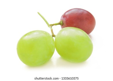 green and red grapes berries closeup isolated on white background, not like everyone else concept