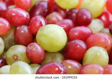 green and red grapes in a bowl
