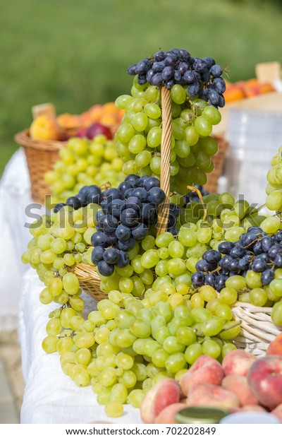 Green and red grapes on the market in Hungary. Close up