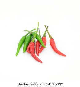 Green and red peppers isolated on white background