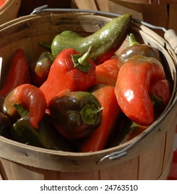 Green and Red Peppers in a wicker basket.