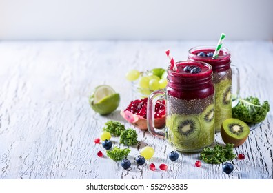 Green and red smoothie with chia, vitamins diet drink fresh detox vegan superfoods copy space