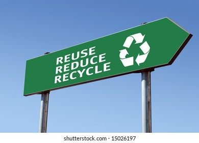 Green reduce-reuse-recycle directional roadsign over blue sky