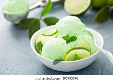 Green refreshing lime ice cream in white bowl