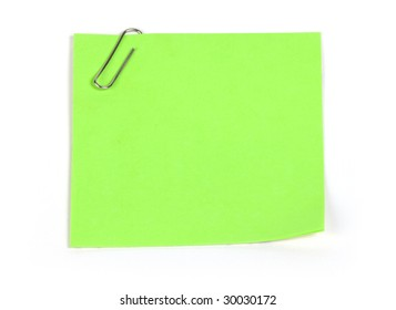 green reminder note on white