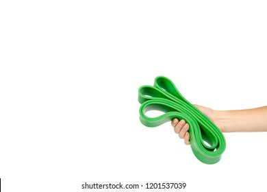 Green resistance band with hand for fitness sport, isolated on white background, copy space template